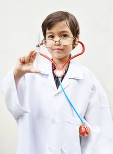 Free Little Boy Pretending To Be A Doctor Royalty Free Stock Images - 33298139