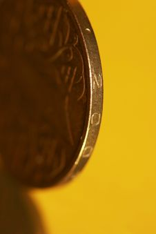 Close-up Of Coins On Yellow Stock Image