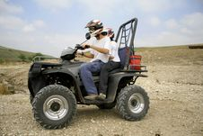 Free Men Riding On A Quad Stock Images - 3332564