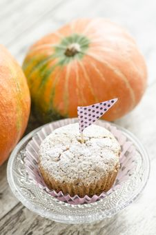 Free Cupcake On Glass Plate. Pumpkin Background Stock Images - 33311284
