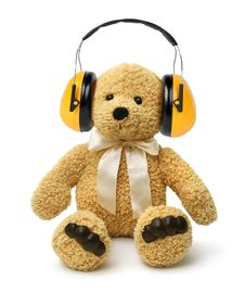 Free Teddy Bear Sitting With Hear Protectors Stock Image - 33320881