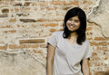 Free Pretty Girl Smiling While Standing Near Brick Wall Stock Images - 33330974