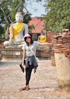 Free Young Girl And Buddha At Wat Yai Chai Mongkol Temple. Ayutthaya Royalty Free Stock Photos - 33330938