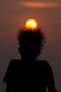 Free Silhouette Of A Man With Golden Sun Rise On His Afro Hair Stock Image - 33342751