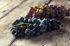 Free Grapes On A Old Wooden Table. Royalty Free Stock Photo - 33365255