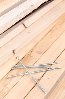 Free Four Nails Lie On The Boards Royalty Free Stock Photography - 33366427
