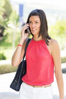 Free Smiling Young Woman Talking By Phone. Royalty Free Stock Photo - 33371265