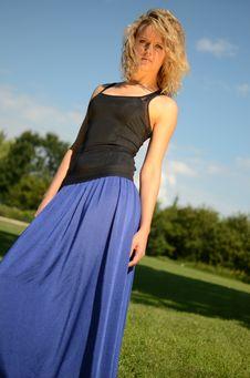 Blond Female Model In Blue Dress Stock Photo