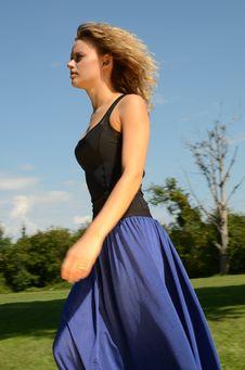 Blond Female Model In Blue Dress Stock Image