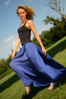 Blond Female Model In Blue Dress Stock Photography