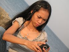 Girl Sending SMS From Holidays Royalty Free Stock Images