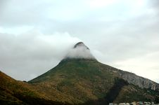 Mountain Peak In Clouds Stock Photo