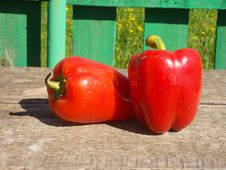Free Two Red Peppers On Table Royalty Free Stock Photo - 33404415