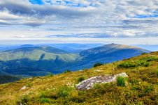 Free Mountain Panorama With Large Rock On The Hillside Royalty Free Stock Photo - 33424125