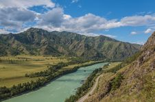 Turquoise River Mountains Sky Royalty Free Stock Photography