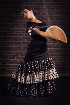 Young Woman Dancing Flamenco With Hand Fan Royalty Free Stock Images