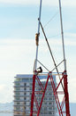 Free Two Workers Install A Lot Of Metal Tiered Tower. Stock Photography - 33491822
