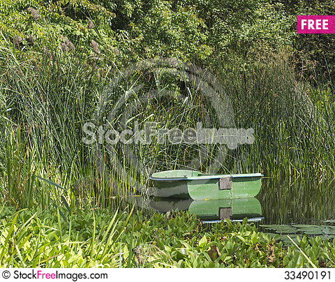 Free Old Boat In Cane Stock Image - 33490191