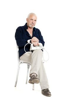 Man Sitting On A Chair And Holding Electric Iron Stock Photography
