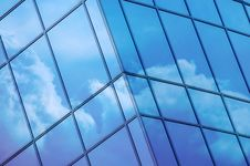 Free Clouds Reflected In Windows Royalty Free Stock Image - 33498726