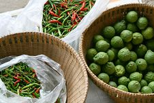 Lime And Chilli Pepper Stock Photos