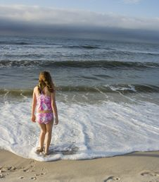 Free Girl Wading In Surf Royalty Free Stock Photos - 3350388