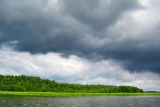 Moody Sky Over Lake. Royalty Free Stock Photo