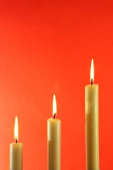 Candles Over Light Red Backgro Royalty Free Stock Photography
