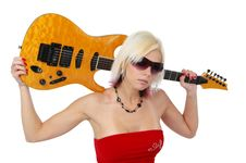 Blonde Girl Holding A Guitar Royalty Free Stock Photography