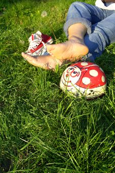 Free Shoes And Bare Feet On Grass Stock Photos - 3358943