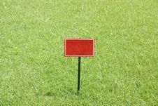 Free Red Billboard In Greensward Stock Photo - 33500560