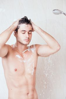 Young Handsome Man In Shower Royalty Free Stock Photography