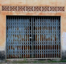 Free Vintage Blue Doors In A Grungy Wall, French Colonial Style, Laos Royalty Free Stock Image - 33513276