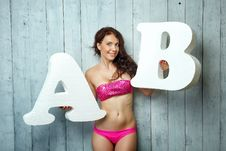 Free Girl In A Bathing And Letters Stock Photos - 33554363