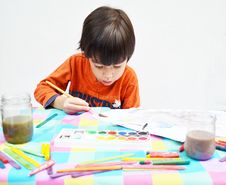 Little Boy Painting Stock Photography