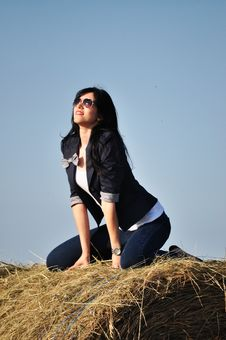 Beautiful Girl Sit On Haystacks Royalty Free Stock Images