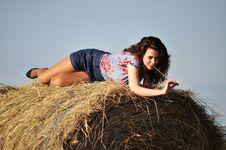 Beautiful Girl Sit On Haystacks Stock Image