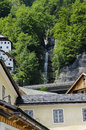 Free Waterfalls Betweens Traditional House In Hallstatt  Austria Stock Photos - 33576373