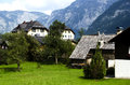 Free Traditional Wooden Houses In Hallstatton The Background Of The Alps Royalty Free Stock Photo - 33577735