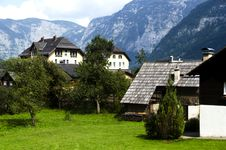 Traditional Wooden Houses In Hallstatton The Background Of The Alps Royalty Free Stock Photo