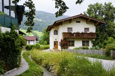 Free Traditional Wooden Houses With Water Stream Near Bybackground Of The Alps Royalty Free Stock Photos - 33578238