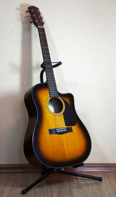 Free Six-string Acoustic Guitar On A Stand Stock Photo - 33592500