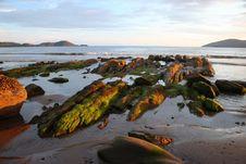 Rocks At Sunset In Irish Bay Royalty Free Stock Photos