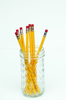 Eight Yellow Pencils In Glass Royalty Free Stock Photography