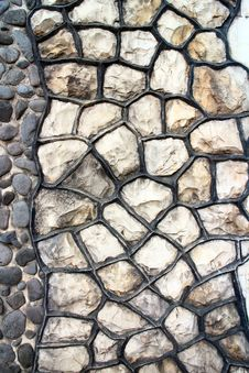 Fragment Of An Modern Handmade Stone Wall As Backgrounds. Royalty Free Stock Photo