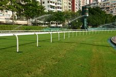 Free Horse Racing Track With Sprinkler Stock Photos - 33662753