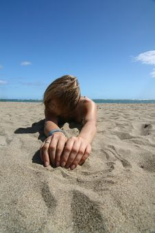 Model Lie At Hot Sand Stock Photo