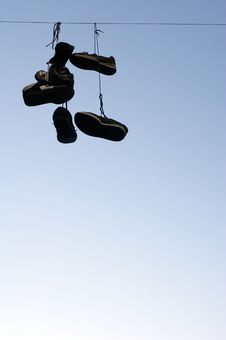 Free Shoes Hanging On A Cable Stock Images - 3373604