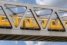Yellow Moving Train On An Iron Bridge With Blue Sky Royalty Free Stock Images