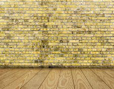 Indoor Background With Yellow Brick Wall And Wooden Plank Floor